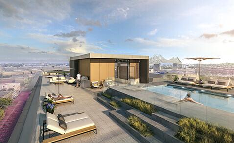 piscine et yoga sur le toit de l'immeuble de condos neufs